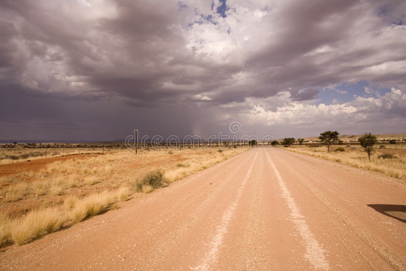 Road on a desert in Africa. Desert road in Africa, heavy sky royalty free stock photo