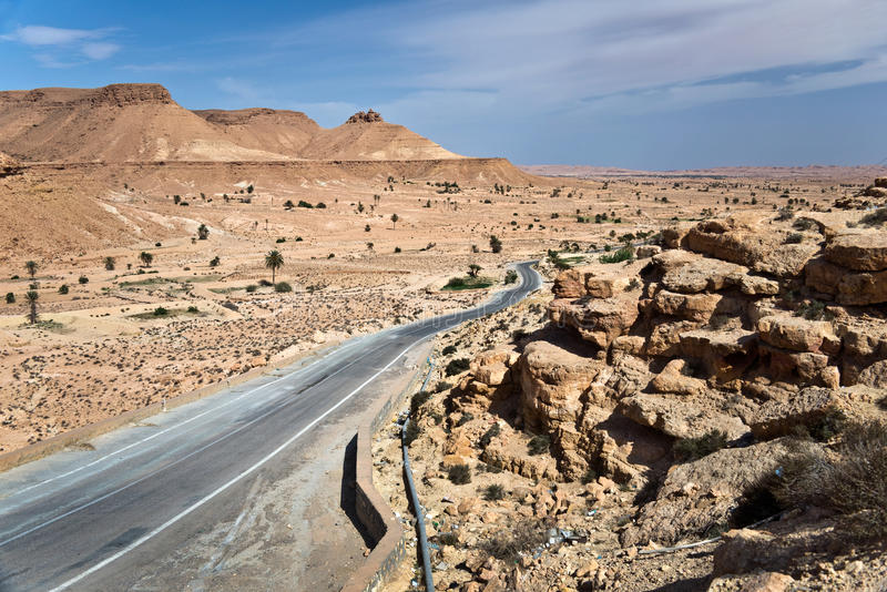 Road in the desert of Sahara. Landscape of the South of Tunisia stock photography