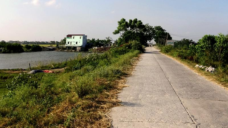 The road on the dike of the countryside in the afternoon is empty stock photo