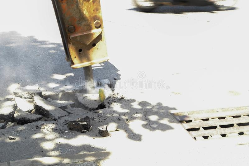 The road drilling machine are Digging road surface. The road drilling machine are Digging road surface stock photo