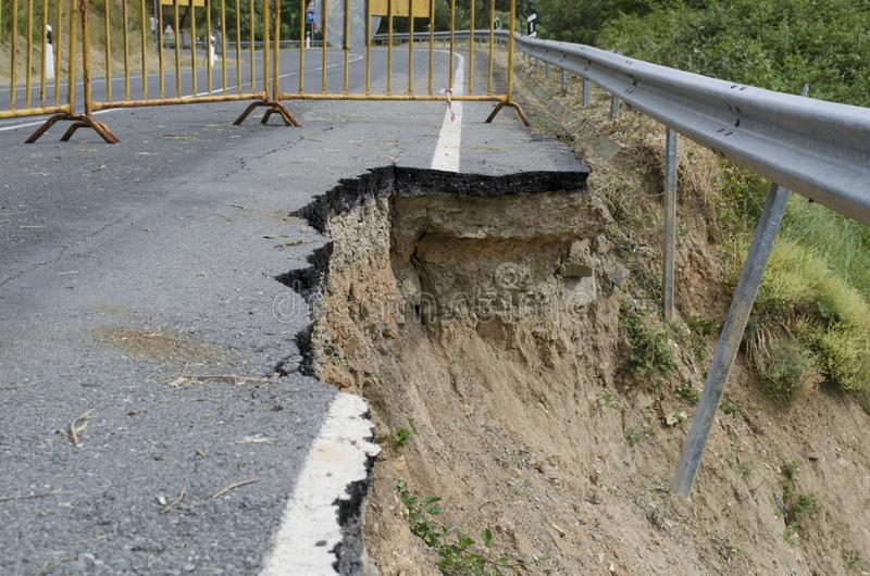 Road erosion. Road Collapse due to erosion stock photo