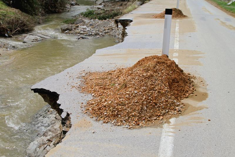 Road Erosion. Dangerous Road Erosion Caused by River Flooding Disaster royalty free stock image