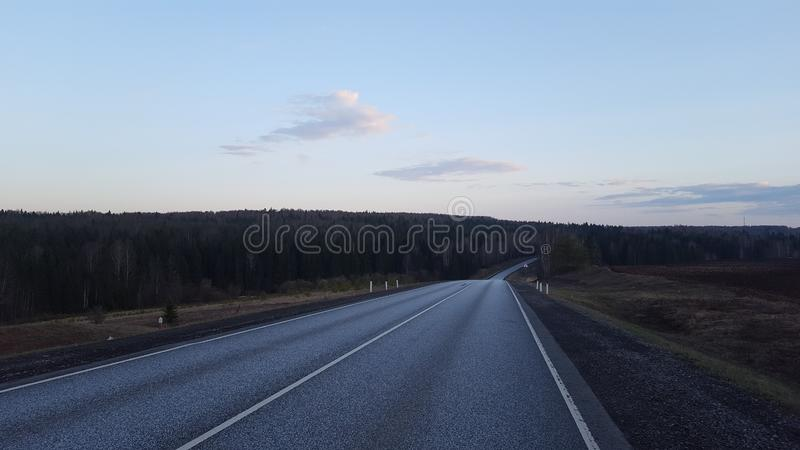 Road in the evening. Night, nature, natural, summer, season, trees, russis, forest, russia, clouds, sky, plant, meadows, fields, landscape, horizon royalty free stock photography