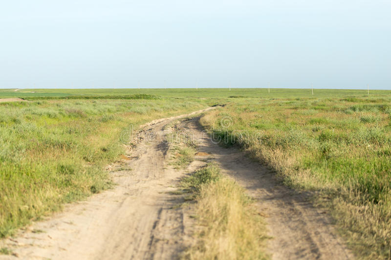 Road in a field stock photography