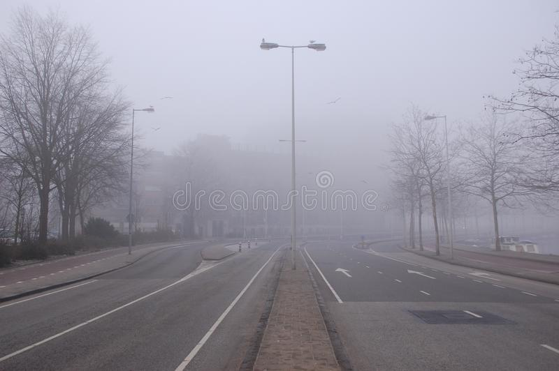 A road in the fog stock photography