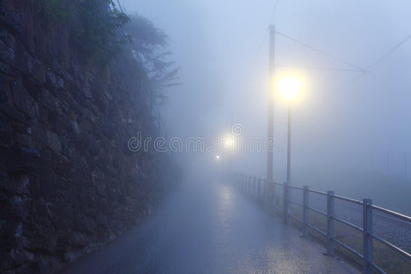 Road in fog dawn stock photos