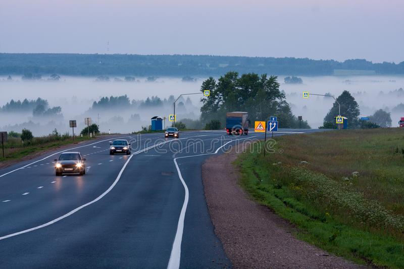 The road in the fog. Morning mist on the road with right-hand traffic royalty free stock images
