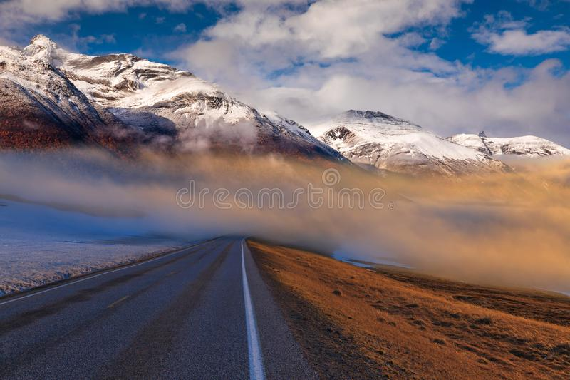 Road in the fog in the mountains, Norway. Beautiful mountain landscape royalty free stock photography