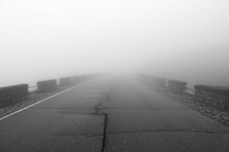 Road in the Fog. Thick Fog and Empty Road. Mystic Foggy Road. Place for Text. The Etna volcano. The island of Sicily, Italy royalty free stock photos