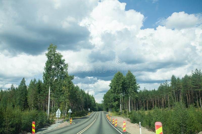 Road and forest with blue sky and clouds.  stock images