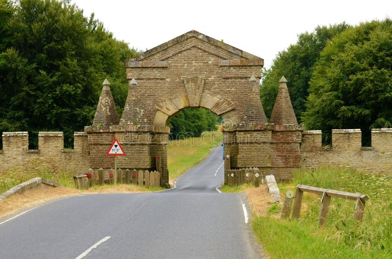 The road and fortified wall at Castle Howard in North Yorkshire. A view of the fortified perimeter wall of the Castle Howard area of North Yorkshire stock photo