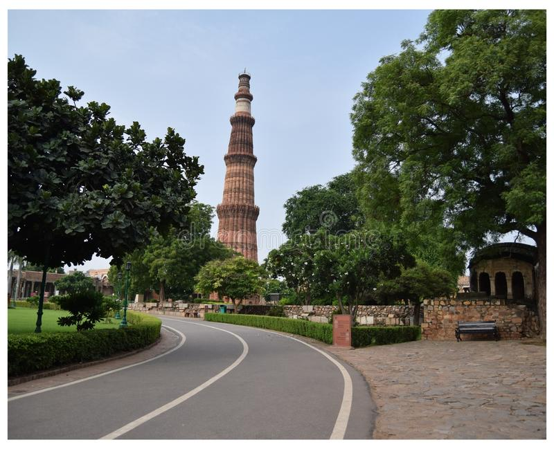 Road going to Qutub Minar in Delhi India, Qutub Minar full view, Delhi Darshan, Must visit places in Delhi. Road going to Qutub Minar in Delhi India, Qutub Minar stock image