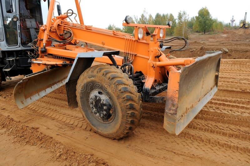 Road grader bulldozer loader royalty free stock photography