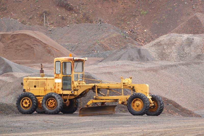 Road Grader. Old road grader in gravel pit stock image