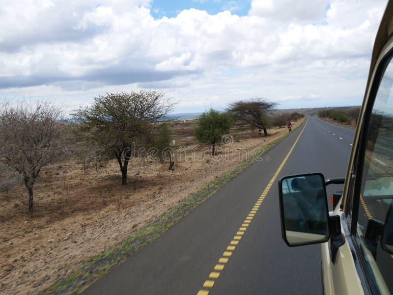 The road of happiness. Cloudy sky in Tanzania, Yellow earth in Africa, Africa, to meet adventures, safaris, Tarangiri, drought, Ngorongoro,gray earth, the stock image