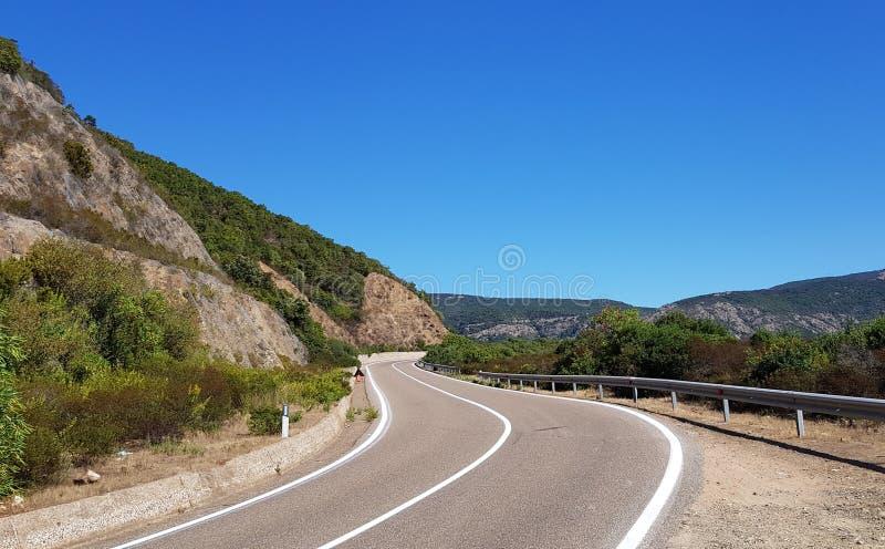 Road between the hills, Buggerru, Sardinia. royalty free stock photography