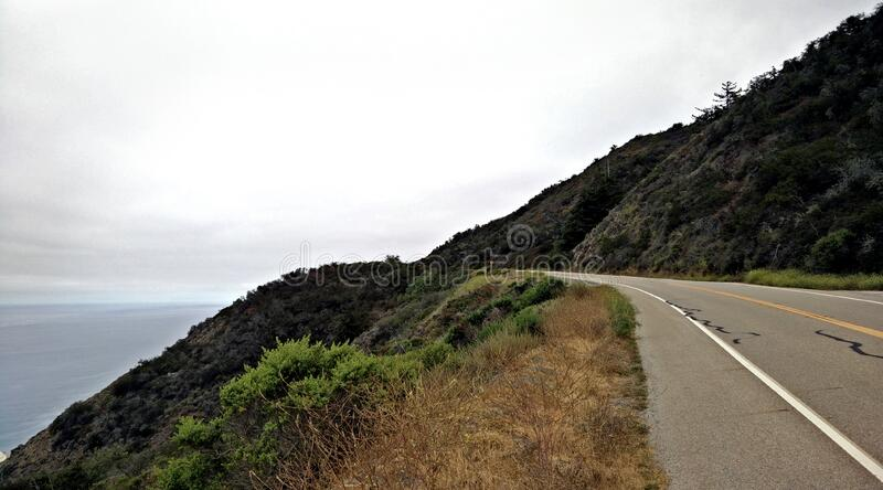 Road on Hillside by Ocean stock photography