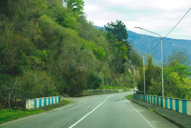 Road through hilly terrain stock photos