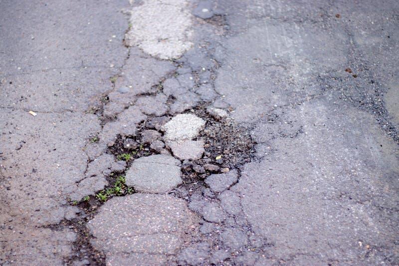 Road holes on the street surface. Transportation, bad, tarmac, asphalt, cracked, car, old, pavement, maintenance, damaged, poor, highway, pit, worn, pothole royalty free stock images