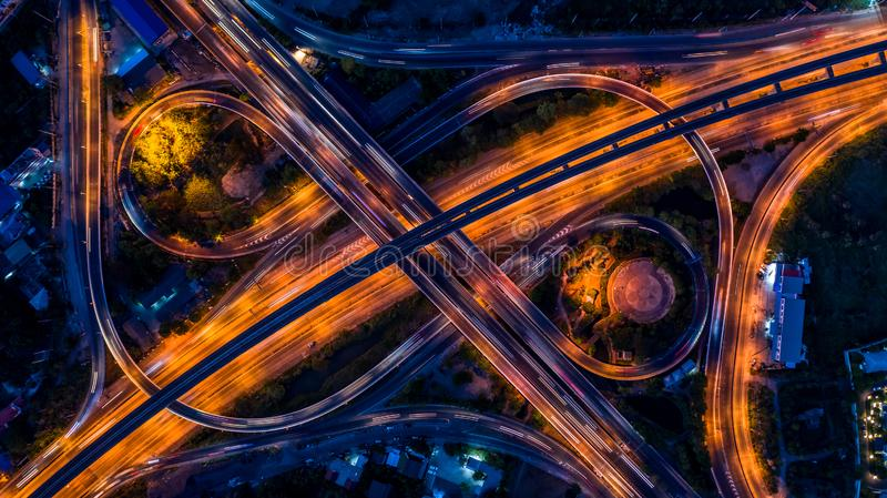 Road interchange in the city at night with vehicle car light movement, Aerial view.  stock photo
