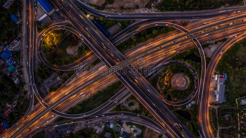 Road interchange in the city at night with vehicle car light movement, Aerial view.  royalty free stock photo