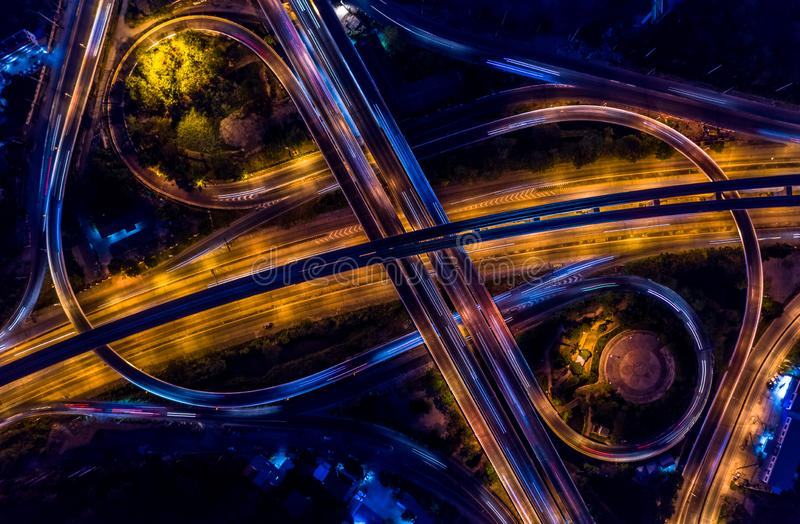 Road interchange in the city at night with vehicle car light movement, Aerial view.  royalty free stock photography