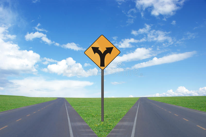 Road intersection and signs. In the grasslands stock photos