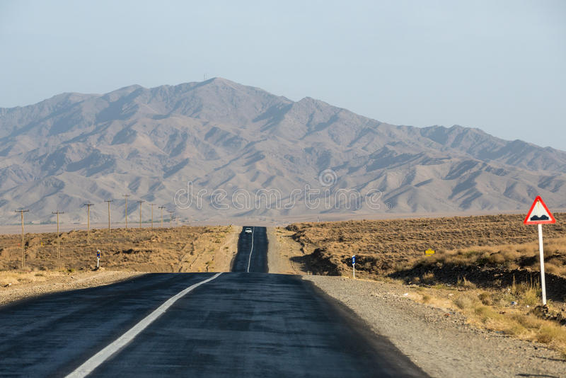 Road in Iran. Straight asphalt road in Isfahan Province in Iran stock photo