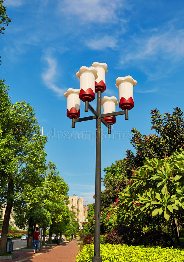 Streetlight road lamp street light post outdoor lighting lamppost. Modern street light pole, lamppost at roadside. Decorative road lamp post for outdoor street stock photography
