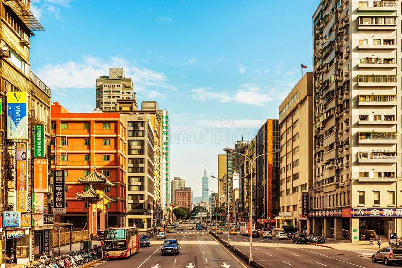 Road and 101 landmark tower building in Taipei, Taiwan. Taipei, Taiwan - January 16, 2018: View at one of the main roads in Taipei and Taipei 101 famous royalty free stock image