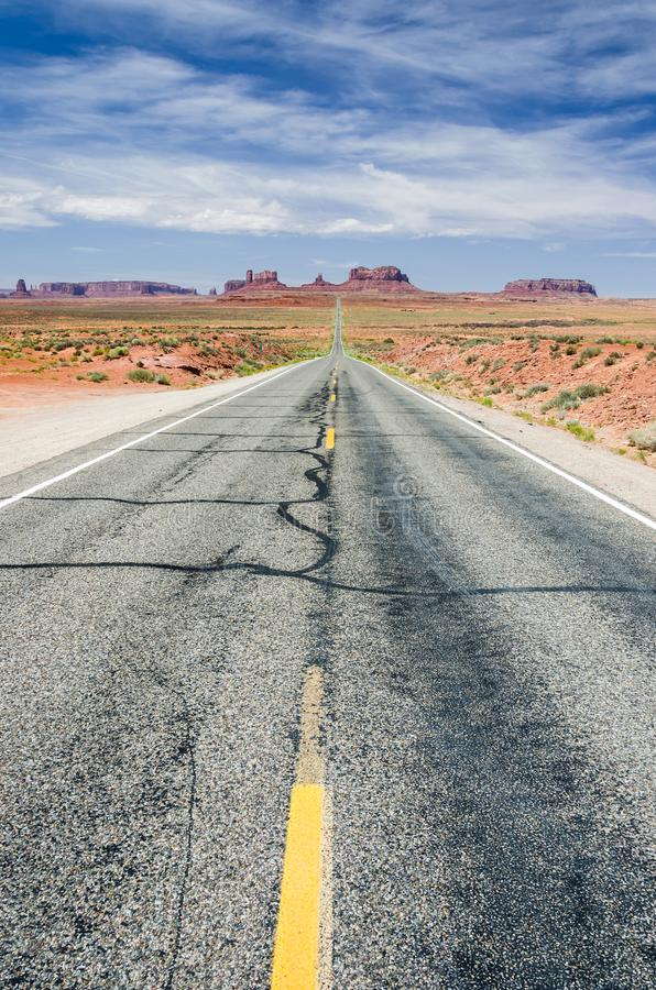 Road leading through beautiful desert landscape towards Monument Valley royalty free stock photos