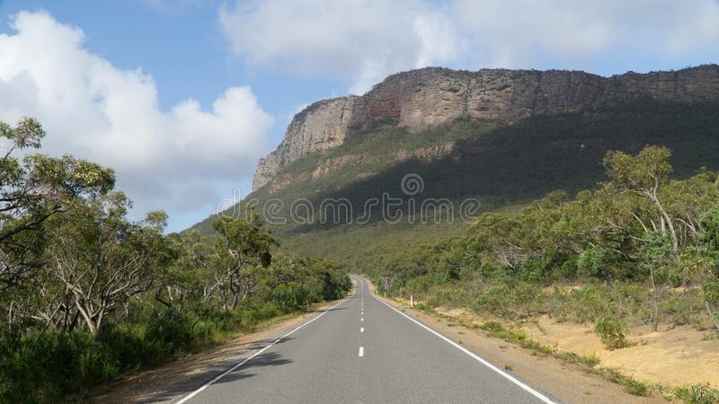 The road leading through the rocky Grampians national park, Australia. The road leading through the rocky Grampians national park in Australia royalty free stock photography