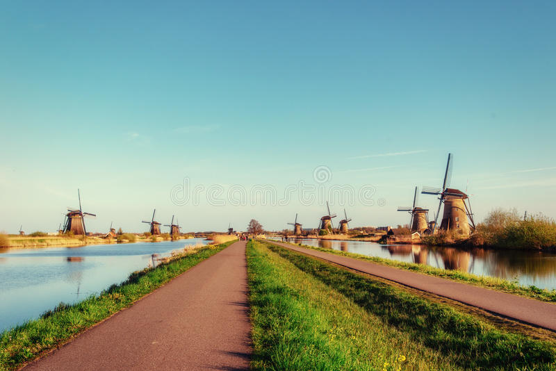 The road leading to the Dutch windmills from the canal. In Rotterdam. Holland. Netherlands royalty free stock images