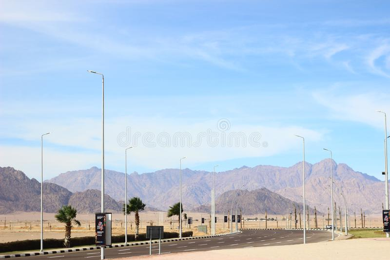 The road leading to the mountains. Egypt in December. Desert, emptiness and solitude. stock image