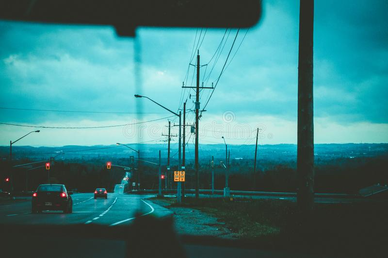 Road With Light Posts from Inside Car's Point of View royalty free stock photo