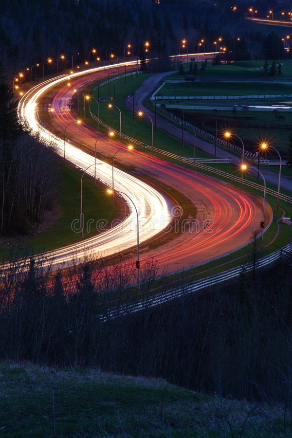 Road and lights of cars. Nightshot of the S shape curve in fox drive, edmonton, alberta, canada stock photography