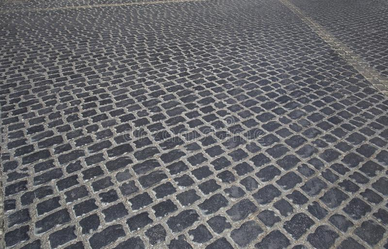 Road lined with cobblestones in the old city in Baku stock images