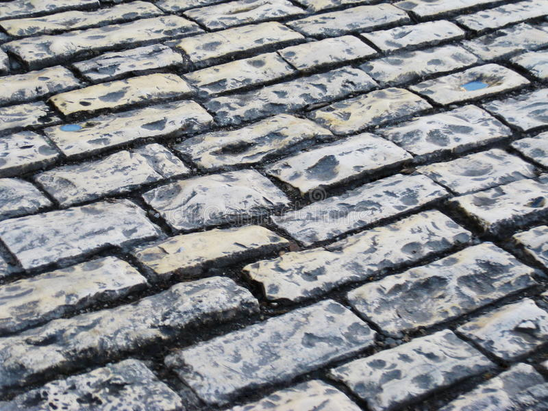 Road lined with stones. Road lined with gray stones, sett royalty free stock photos