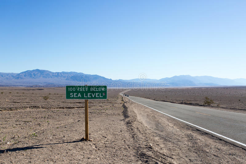 Road 100m Below Sea Level Death Valley. Roads run below sea level in Death Valley National Park. The barren land was once covered by a sea but no more royalty free stock images