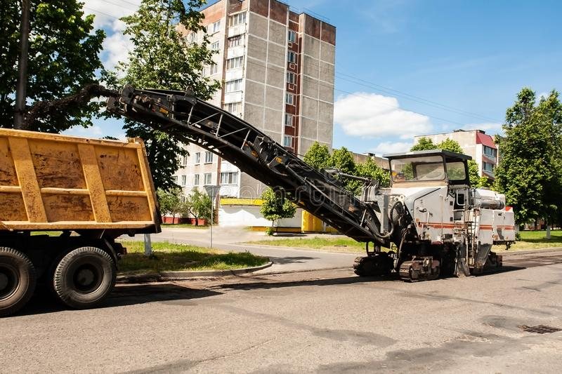 Road machinery removes old asphalt royalty free stock photography