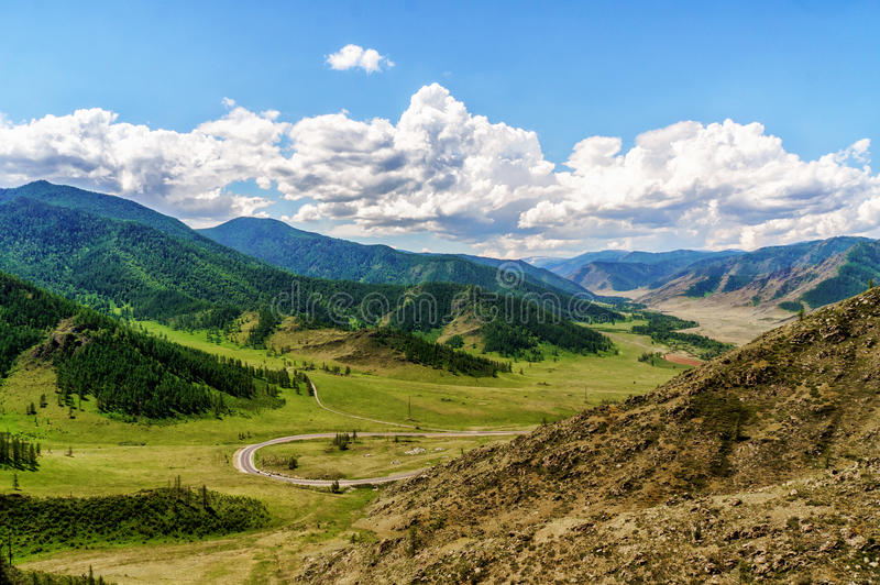 Road making loops and turns over mountain pass stock image