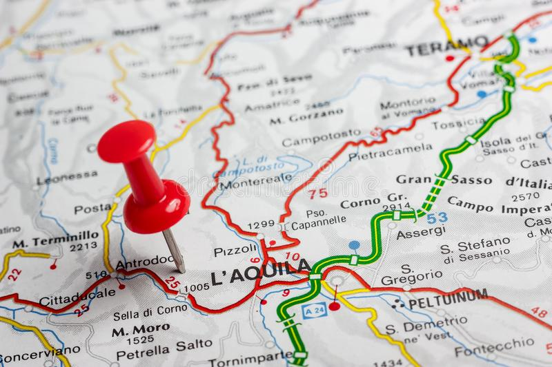 L& x27; Aquila pinned on a map of Italy. Road map of the city of L& x27; Aquila Italy royalty free stock image