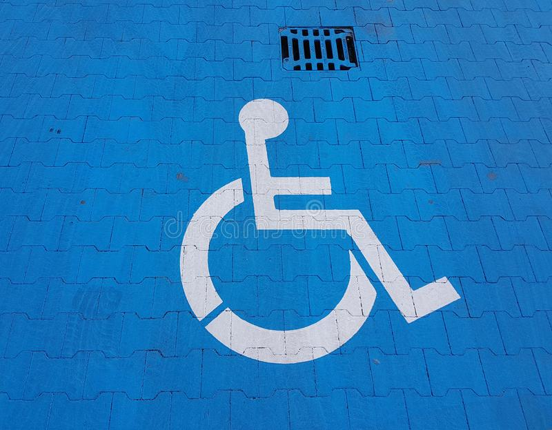 Road marking sign on a blue background denoting parking for a disabled vehicle. The convenience of parking a vehicle. The journey royalty free stock photography