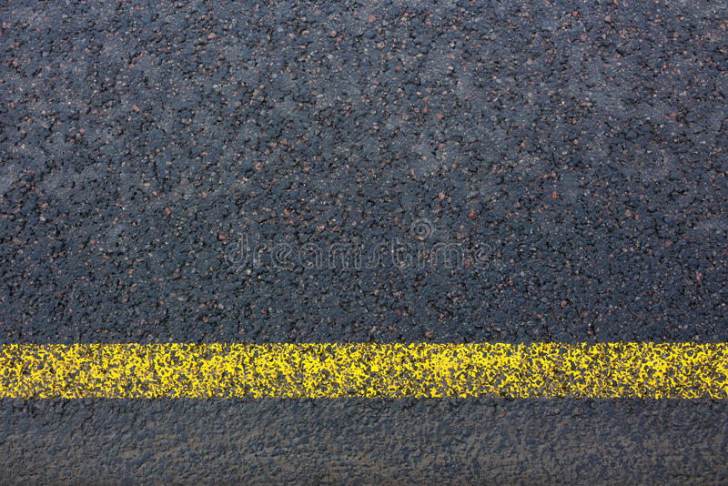 Road marking with yellow lines on dark asphalt royalty free stock photos