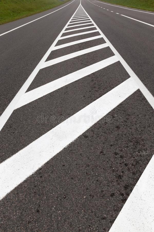 Road markings. For pedestrian safety, closeup on asphalt road royalty free stock image