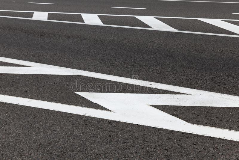 Road markings. For pedestrian safety, closeup on asphalt road royalty free stock images