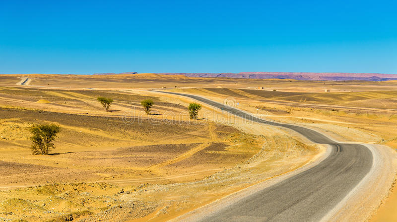 Road Merzouga - Erfoud in Morocco. Road Merzouga - Erfoud in the Moroccan Sahara desert royalty free stock photography