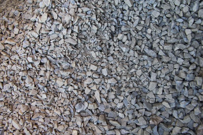 Road-metal for background. Macadam. ballast. broken stone. breakstone. scree. small rock. Natural grey stones for background. Too many of grey stones royalty free stock image