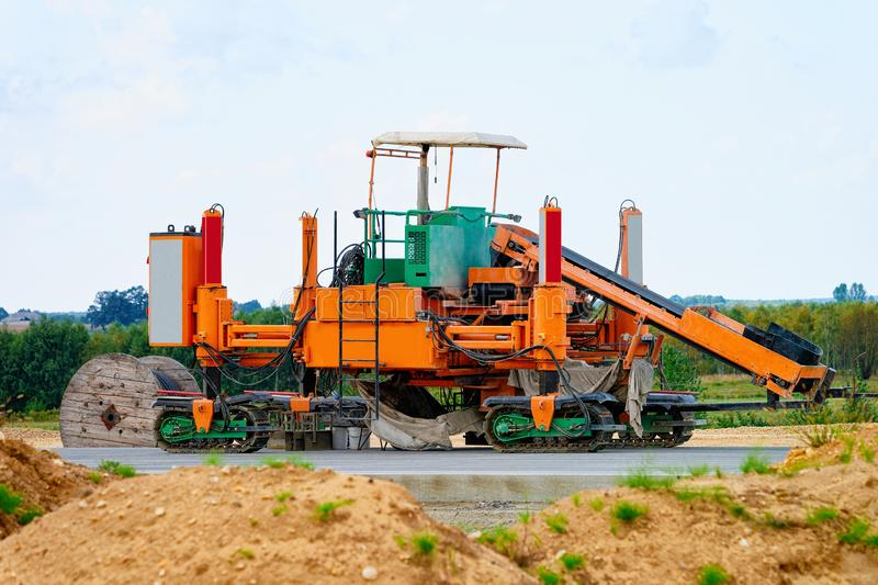 Road milling machine on highway road in Poland stock photo