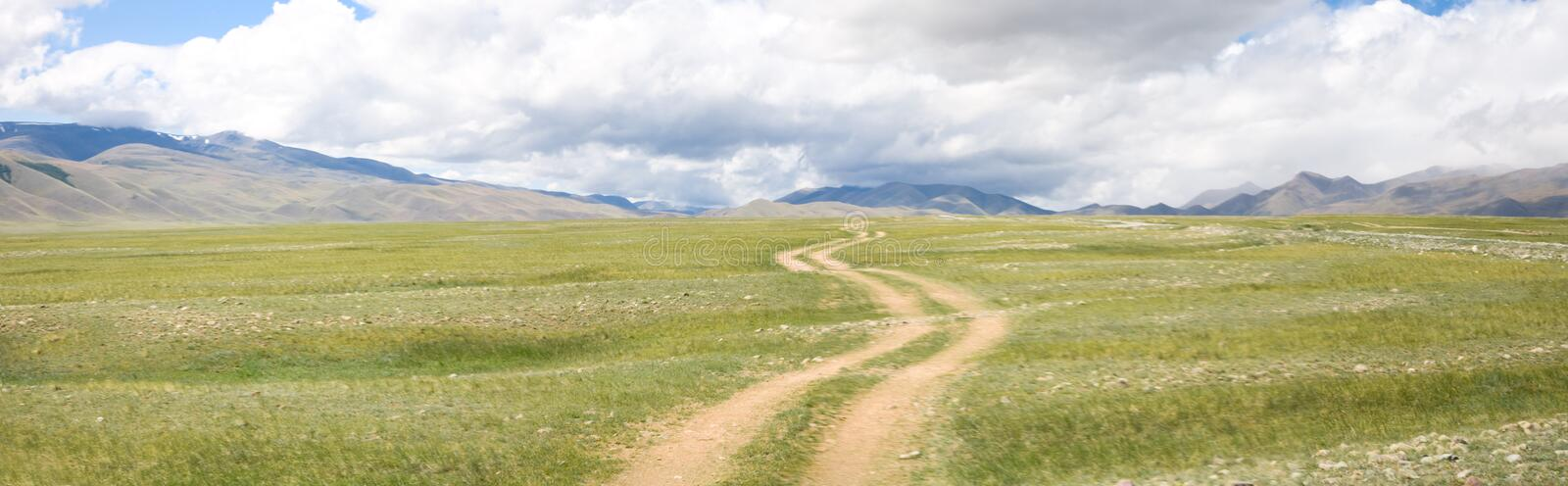 Road in the mountain steppes royalty free stock images